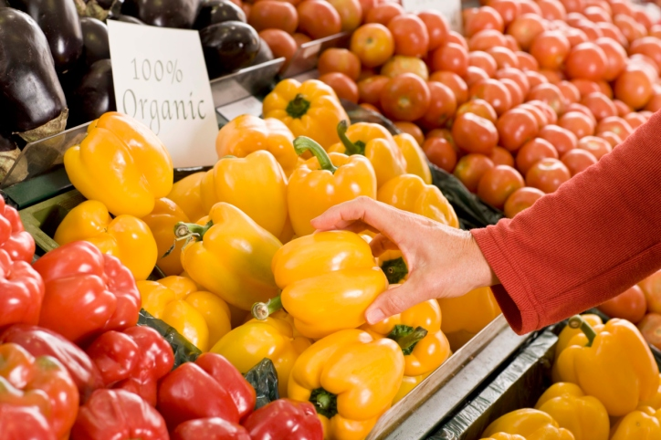 Picture of woman shopping for peppers