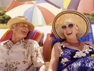 Senior Couple Sitting on Sun loungers on a Beach