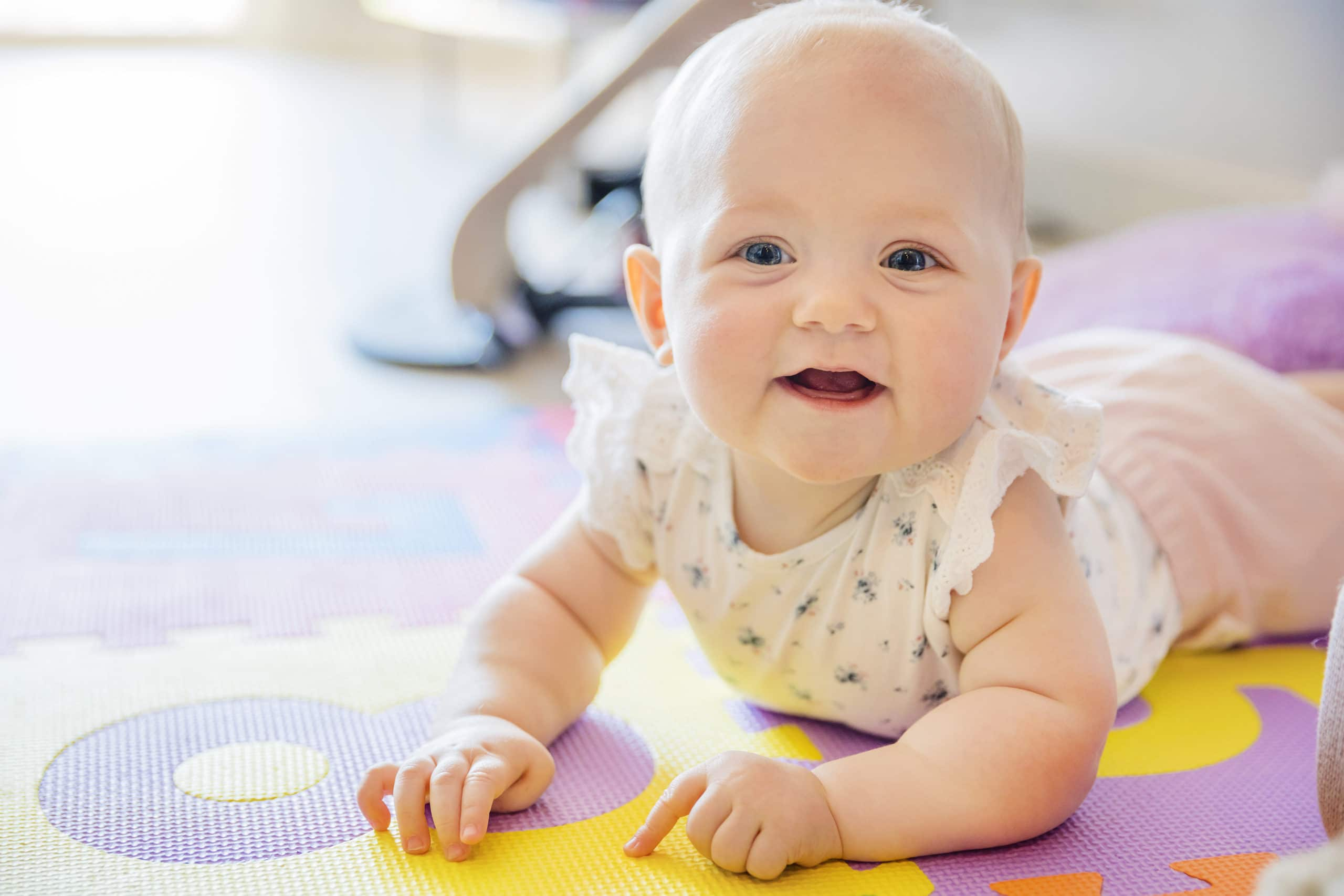 Picture of a baby girl doing tummy time