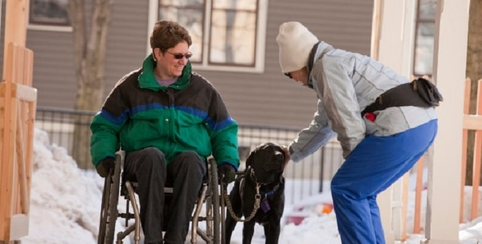Picture of woman in wheelchair with service dog