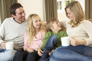 Parents and kids on sofa