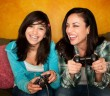 Parent and child smiling and playing video game together