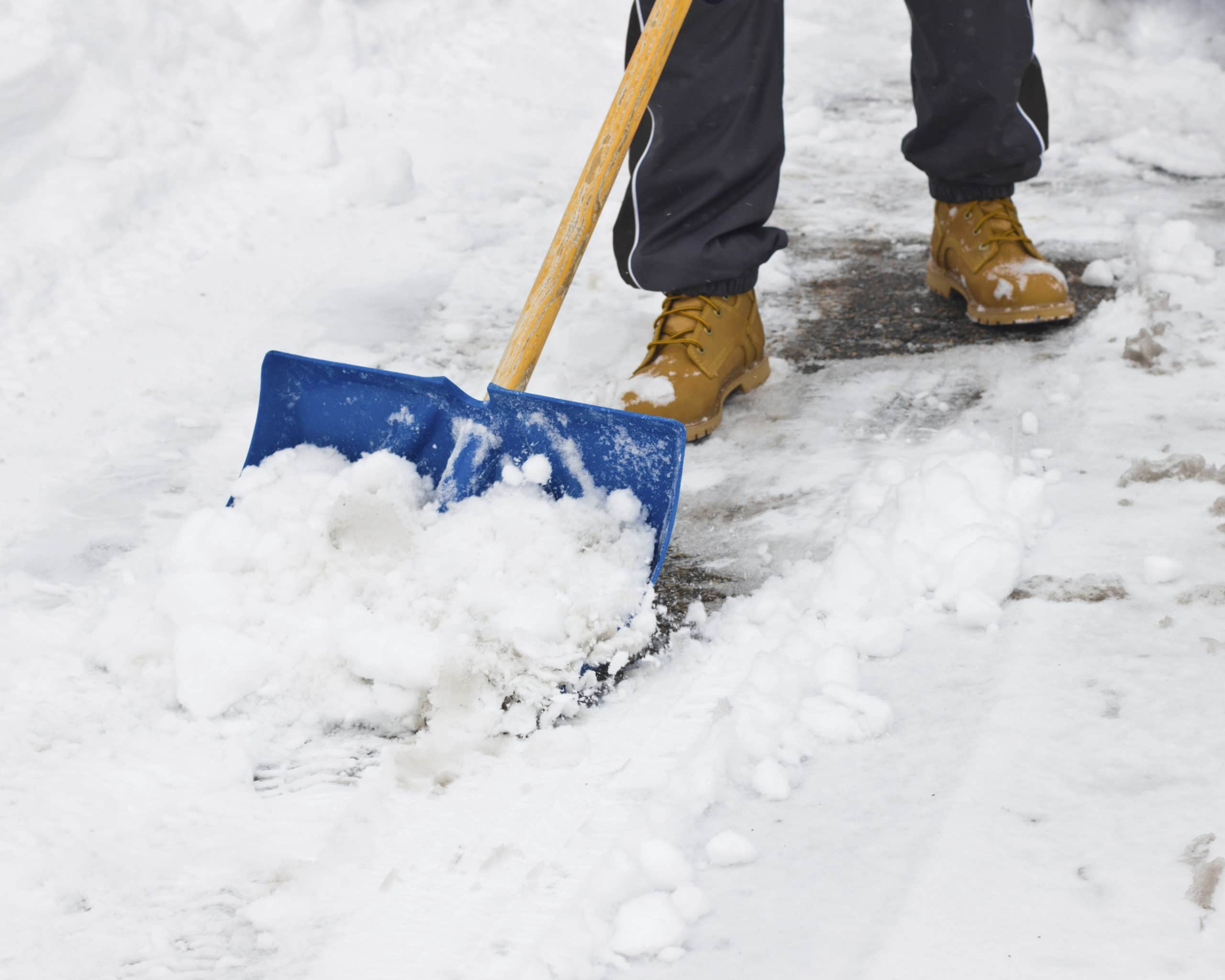 Picture of man shovelling snow
