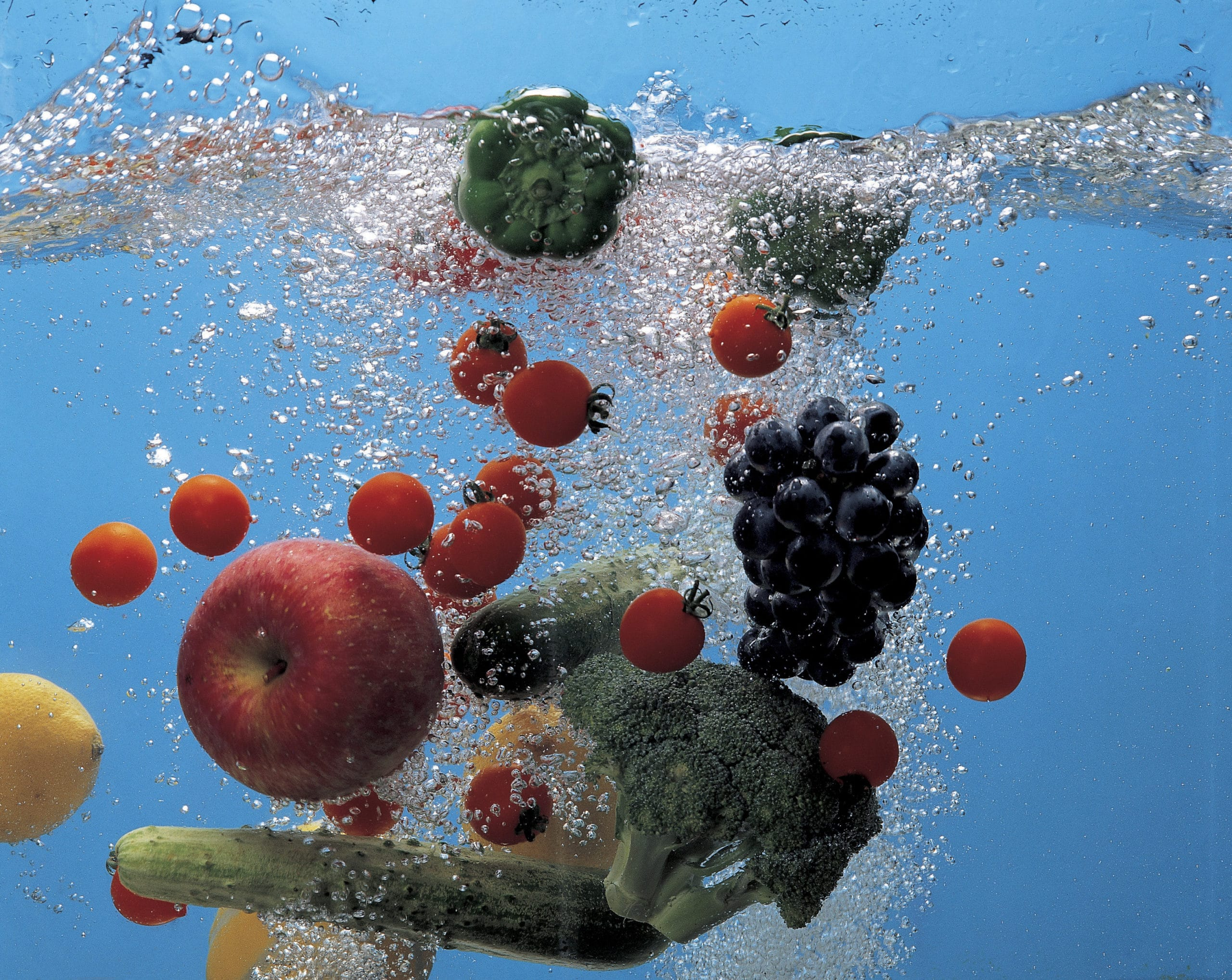 Fresh fruit and vegetables in fresh clear water