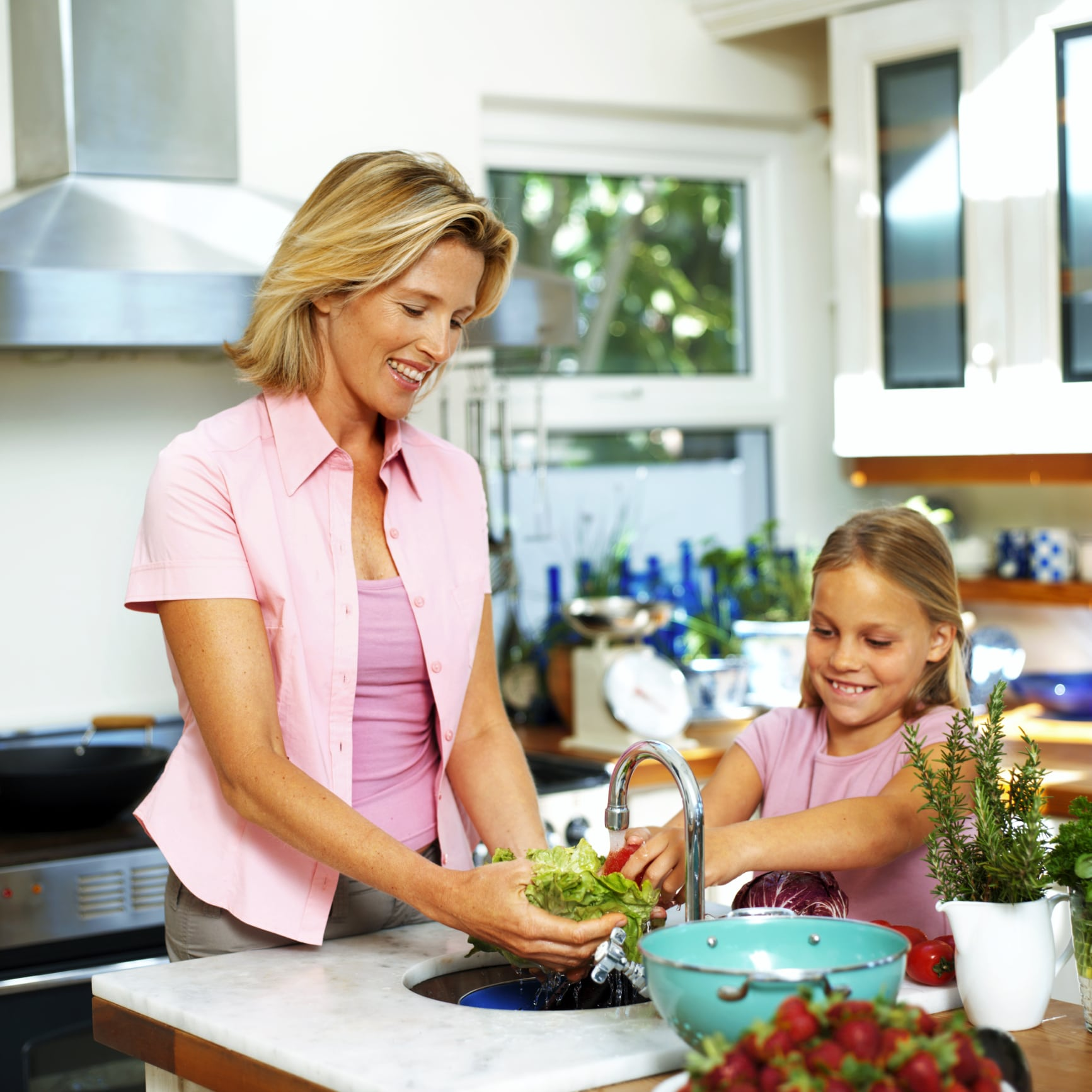 Picture of mother and daughter making salad