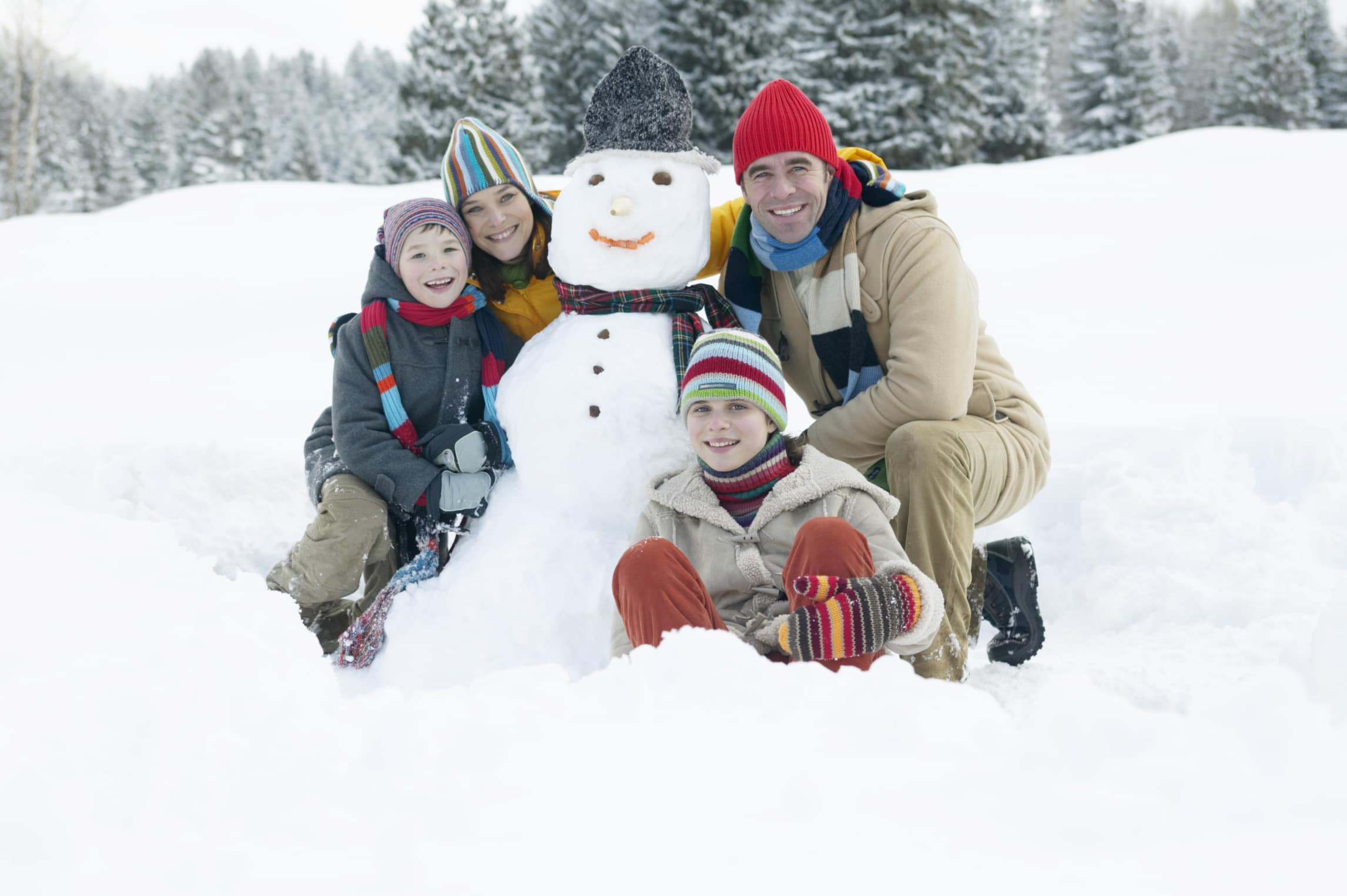 Picture of family building a snowman
