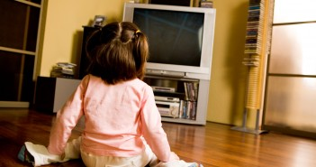 Picture of kid watching cartoons