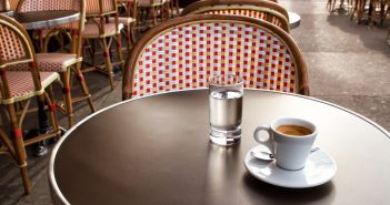 Coffee and water on a table of parisian's bar