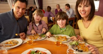 Image of family eating out