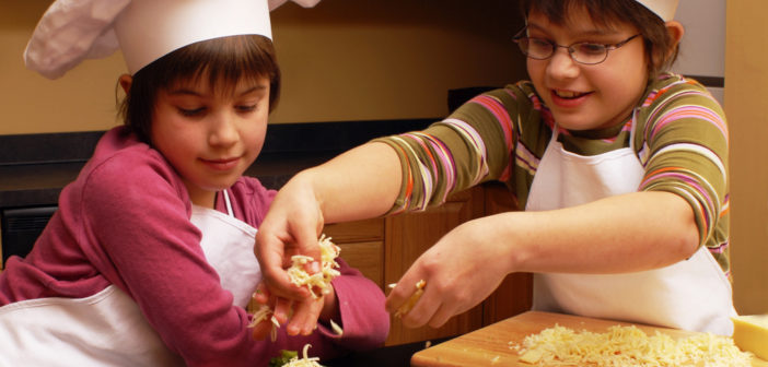 Picture of two children making pizza