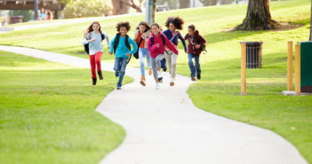 Image of kids running down a path