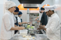 People preparing food in a commercial kitchen