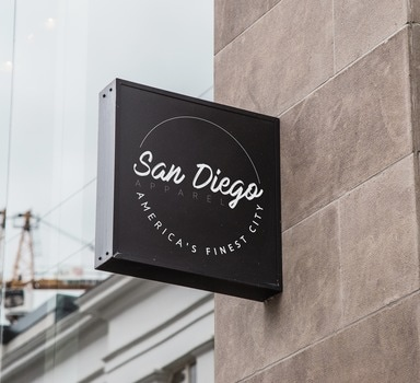 An image with a sign that reads: San Diego Apparel Americas Finest City