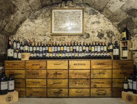 An image that depicts a large wine collection along a stack of boxes