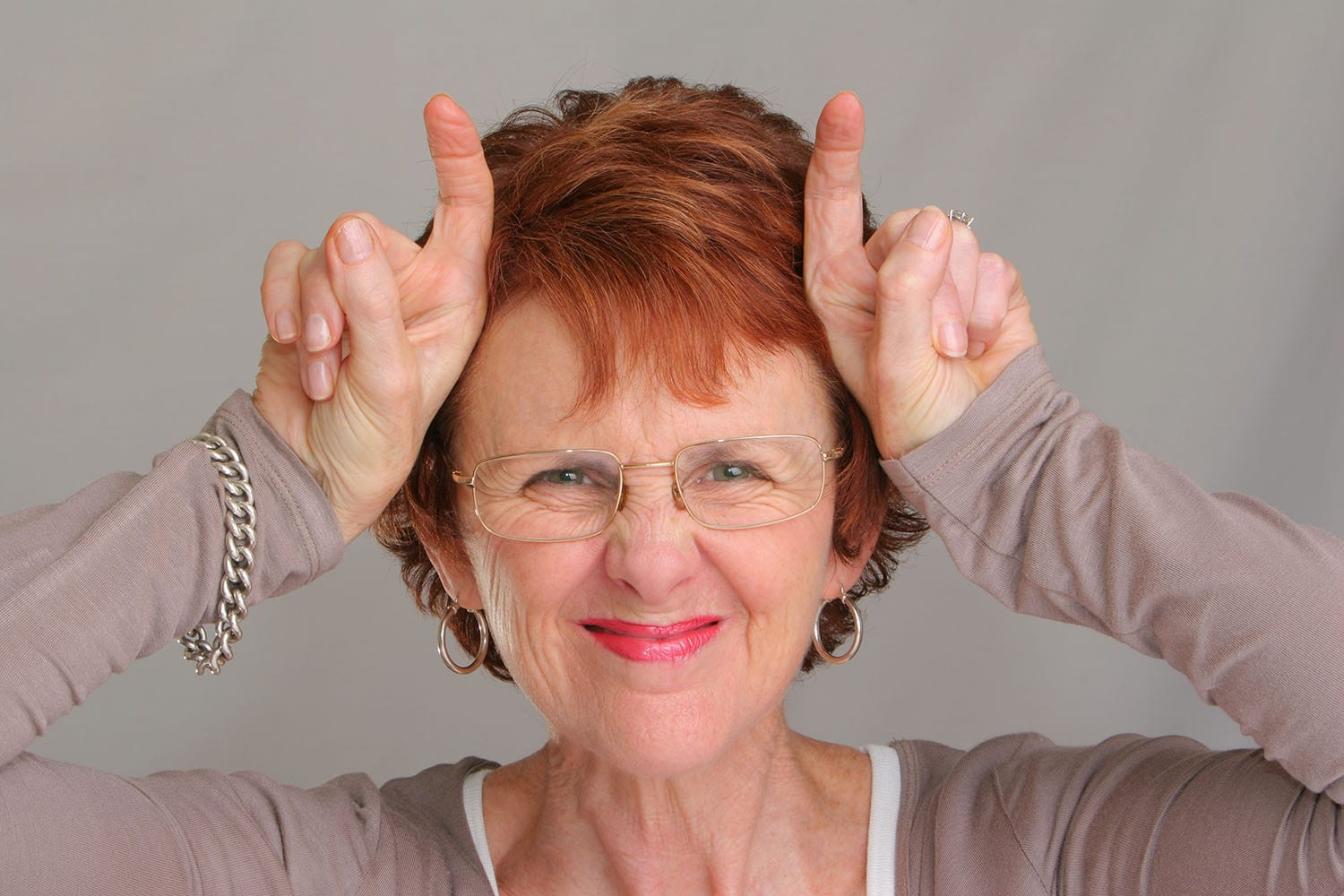 Woman simulating horns with her fingers
