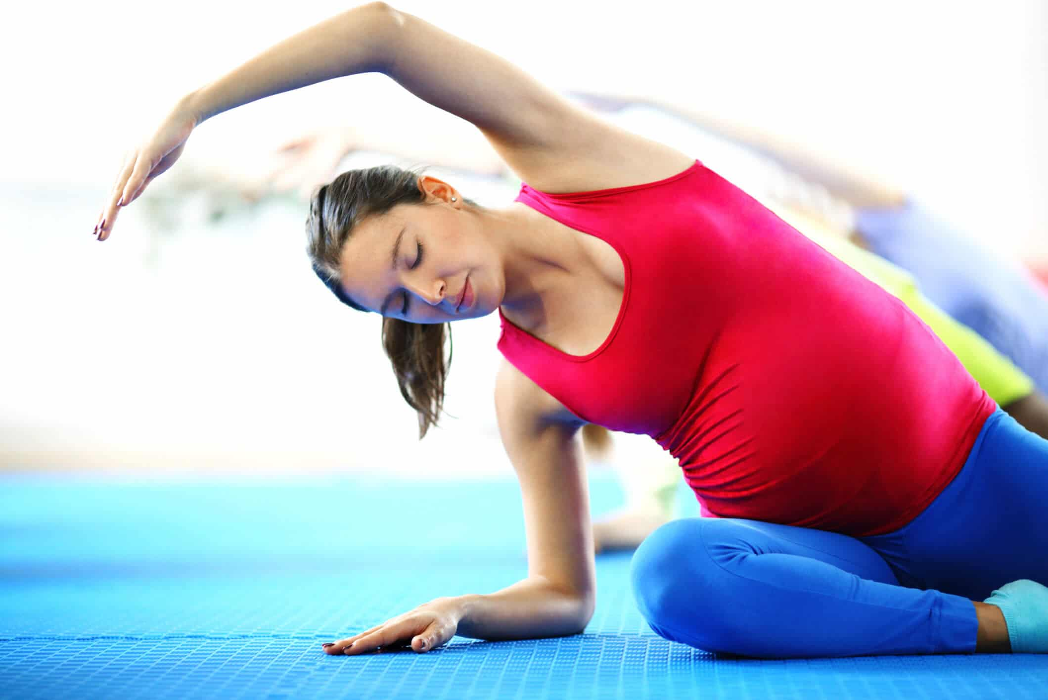 Pregnant woman doing stretches