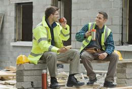 Low resolution image of two workers on a break