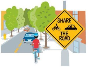 Share the road sign with car and bike