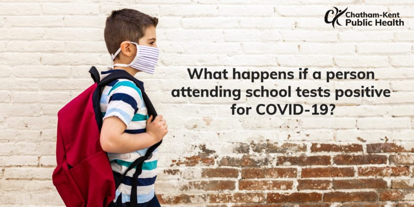 What happens if a person attending school tests positive for COVID-19?