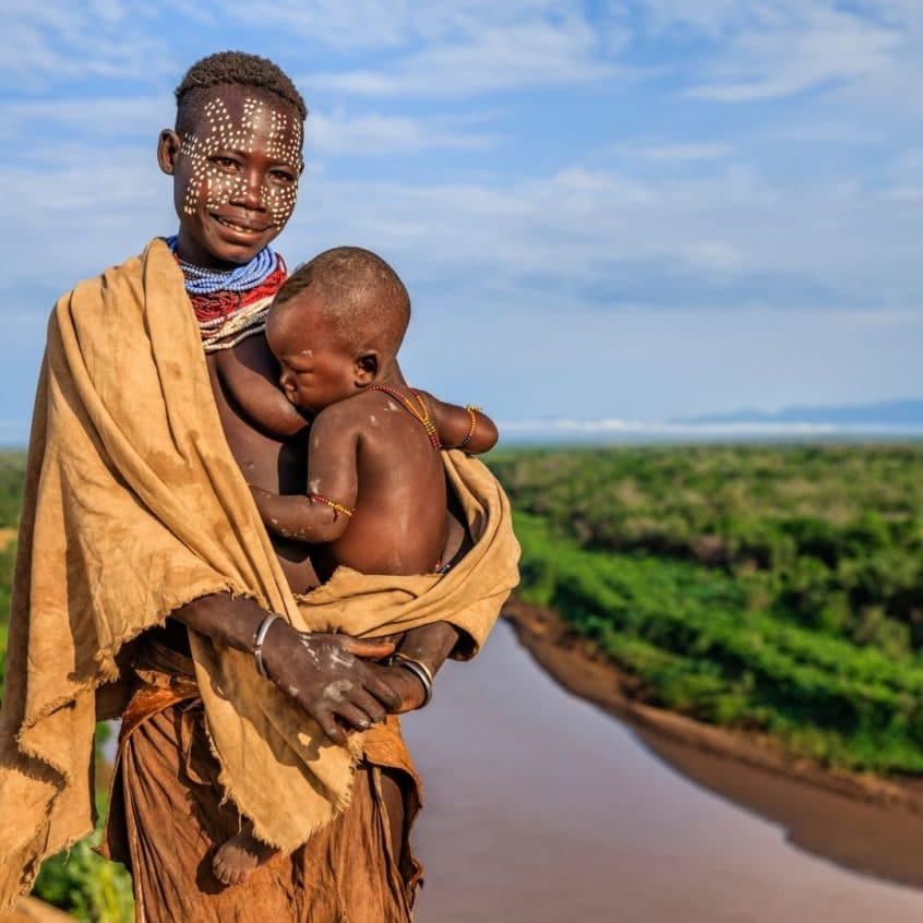 Woman in Ethiopia breastfeeding outside
