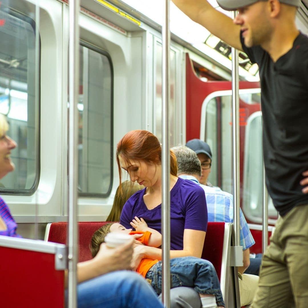 Woman breastfeeding on subway